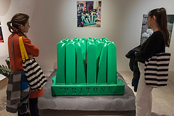 """© Licensed to London News Pictures. 06/11/2018. LONDON, UK. Visitors view """"Pratone"""", 1971, by Ceretti, Derossi & Rossi.  Preview of """"Home Futures"""", at the Design Museum.  The exhibition, in partnership with IKEA Museum Almhult, asks are we living in the way that pioneering architects and designers once predicted, or has our idea of home proved resistant to real change?  More than 150 objects and experiences are on display 7 November to 24 March 2019.  Photo credit: Stephen Chung/LNP"""