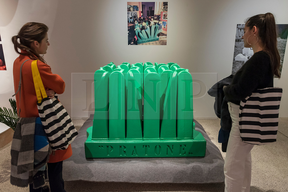 "© Licensed to London News Pictures. 06/11/2018. LONDON, UK. Visitors view ""Pratone"", 1971, by Ceretti, Derossi & Rossi.  Preview of ""Home Futures"", at the Design Museum.  The exhibition, in partnership with IKEA Museum Almhult, asks are we living in the way that pioneering architects and designers once predicted, or has our idea of home proved resistant to real change?  More than 150 objects and experiences are on display 7 November to 24 March 2019.  Photo credit: Stephen Chung/LNP"