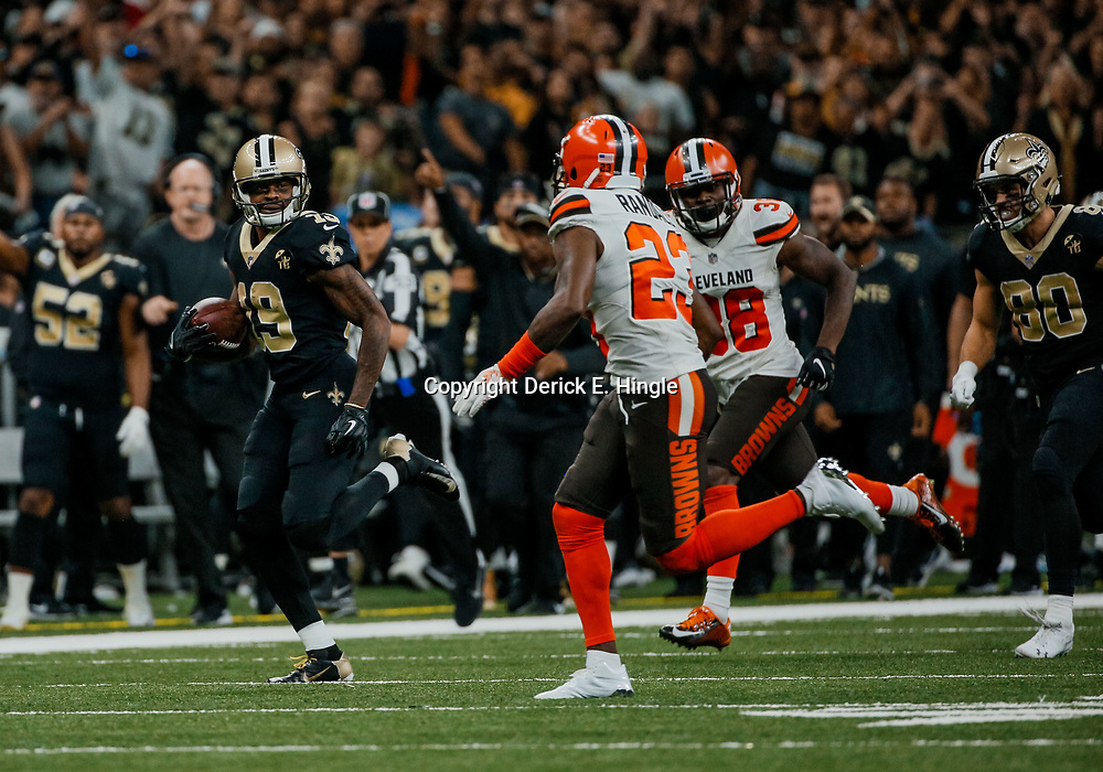 Sep 16, 2018; New Orleans, LA, USA; New Orleans Saints wide receiver Ted Ginn Jr. (19) breaks away from Cleveland Browns cornerback Damarious Randall (23) and cornerback E.J. Gaines (28) during the fourth quarter of a game at the Mercedes-Benz Superdome. The Saints defeated the Browns 21-18. Mandatory Credit: Derick E. Hingle-USA TODAY Sports