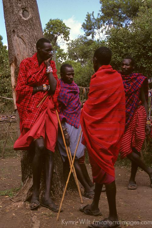 Africa, Kenya, Maasai Mara. Maasai elders and their sticks.