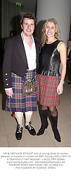 MR & MRS MARK STEWART, son of racing driver Sir Jackie Stewart, at a party in London on 25th January 2002.	OWX 119