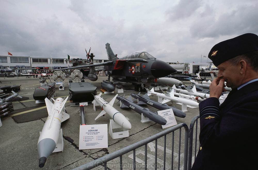 A uniformed man seems to enjoy looking at the missiles on display at the Paris Air Show, at Le Bourget Airport, France. Held every other year, the event is one of the world's biggest international trade fairs for the aerospace business.