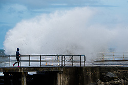 © Licensed to London News Pictures. 12/06/2017. Aberystwyth, Wales, UK. Waves hit the wall as unseasonal storms and gale force winds and high tides combine to bring huge waves crashing into the promenade and sea defences in Aberystwyth, Wales  .Photo credit: Keith Morris/LNP