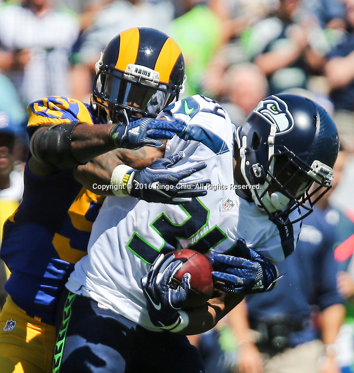 Seattle Seahawks running back Thomas Rawls (34) is defended by Los Angeles Rams outside linebacker Alec Ogletree (52) during a NFL football game, Sunday, Sept. 18, 2016, in Los Angeles. The Rams won 9-3. (Photo by Ringo Chiu/PHOTOFORMULA.com)<br /> <br /> Usage Notes: This content is intended for editorial use only. For other uses, additional clearances may be required.