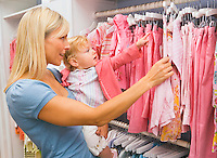 Mother and Toddler shopping for kids clothes ina childrens clothing boutique..Model Property/Releases.20070820_MR_B.20070820_MR_C.20070820_PR_A