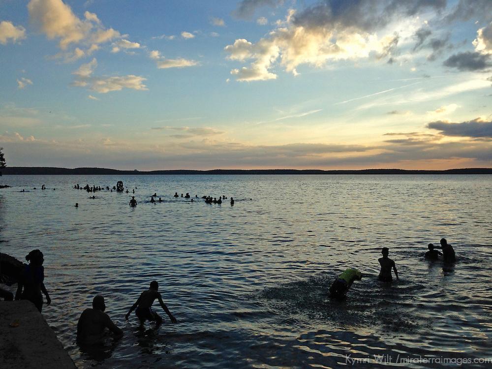 Central America, Cuba, Cienfuegos. Local Cubans swim in the waters off Punta Gorda in Cienfuegos, Cuba.