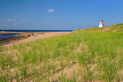 Lighthouse on sand dunes at Cape Stanhope. Covehead Harbour<br /> Prince Edward Island National Park<br /> Prince Edward Island <br /> Canada