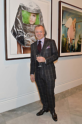 GRAHAM NORTON at a private view of photographs by David Bailey entitled 'Bailey's Stardust' at the National Portrait Gallery, St.Martin's Place, London on 3rd February 2014.