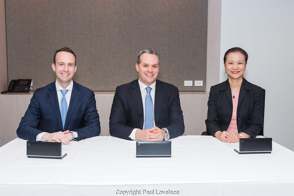 GenesisCare sign agreement with Chinese Investor at Herbert Smith Freehills, Sydney. L/R Sitting at table Gareth Woodbridge, Dan Collins and Kerry Zhang Kai.