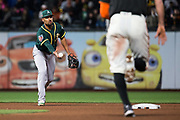 Oakland Athletics shortstop Marcus Semien (10) flips the ball to second base for a double play against the San Francisco Giants at AT&T Park in San Francisco, California, on March 26, 2018. (Stan Olszewski/Special to S.F. Examiner)