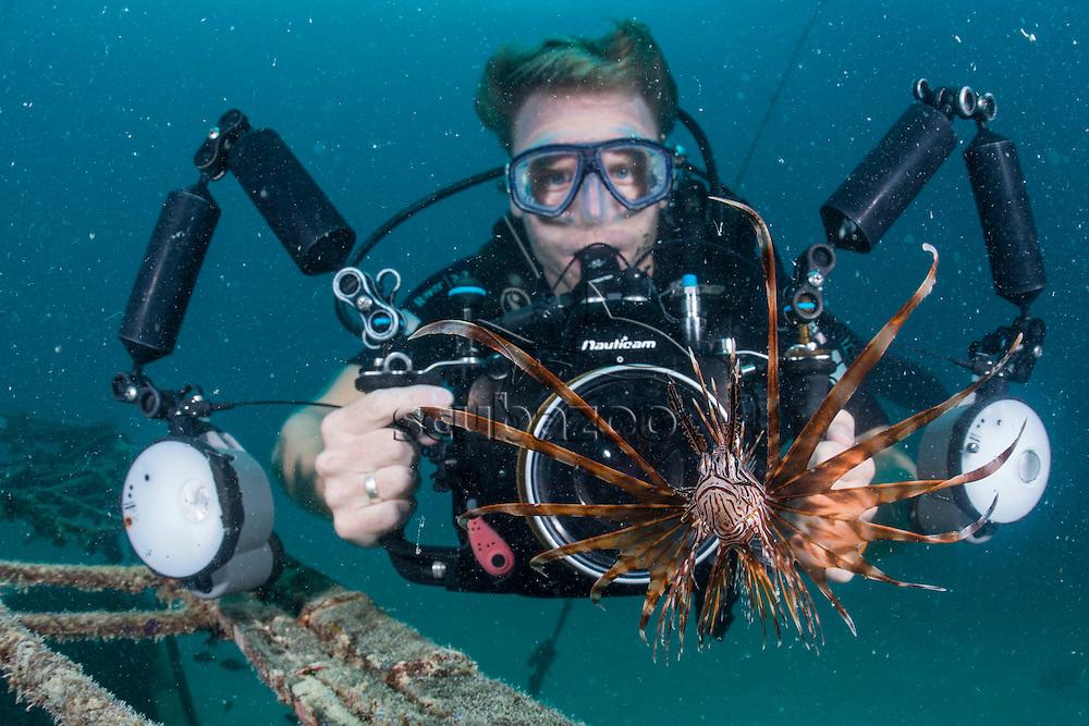 Photographer and a Common Lionfish, Pterois volitans, Mabul, Sabah, Malaysia, Borneo, Celebes Sea,