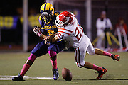 Saratoga's Jordan Vogel (21) tackles Milpitas' Tre Hartley (2) during a loose ball on a punt return during homecoming against Saratoga at Milpitas High School in Milpitas, California, on October 11, 2013.  Milpitas beat Saratoga 54-14. (Stan Olszewski/SOSKIphoto)