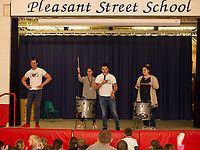 "Ryan Vezina and Justin Spencer of Recyled Percussion bring Porcia Magdziasz and Maggie Dehm on stage for a ""drum off"" during their visit to Pleasant Street School Friday afternoon.  (Karen Bobotas/for the Laconia Daily Sun)"