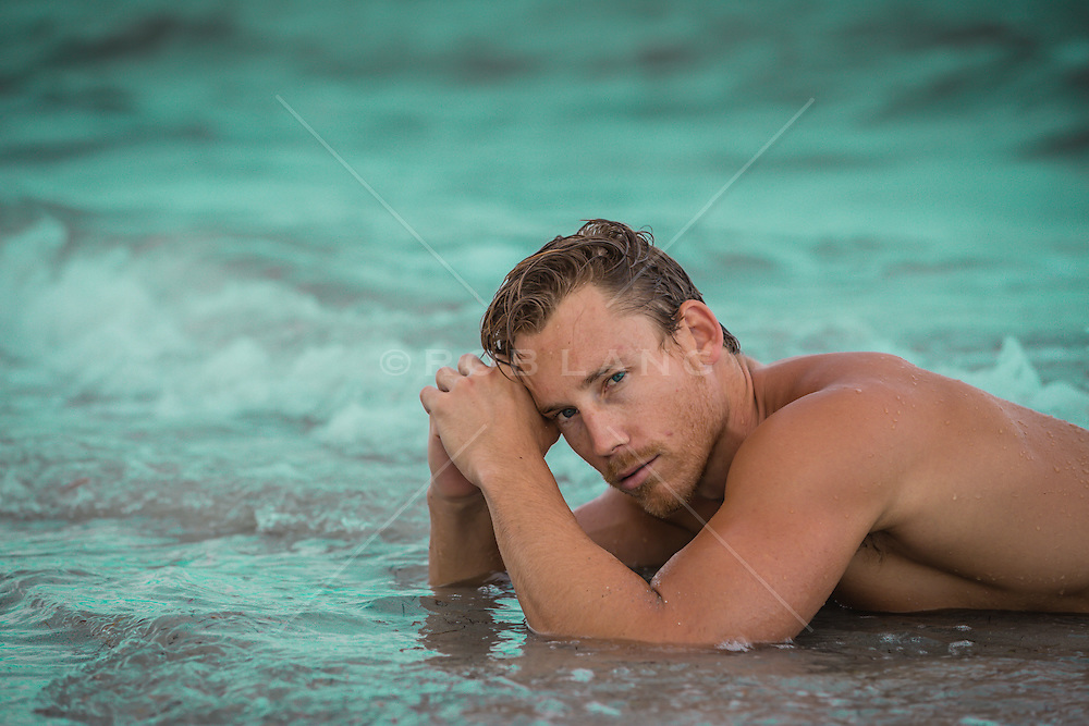 sexy man in the ocean water of Miami. FL