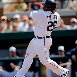 Feb 27, 2013; Lakeland, FL, USA; Detroit Tigers first baseman Prince Fielder (28) hits a two run homerun scoring third baseman Miguel Cabrera (24) during the bottom of the first inning of a spring training game against the Atlanta Braves at Joker Marchant Stadium. Mandatory Credit: Derick E. Hingle-USA TODAY Sports