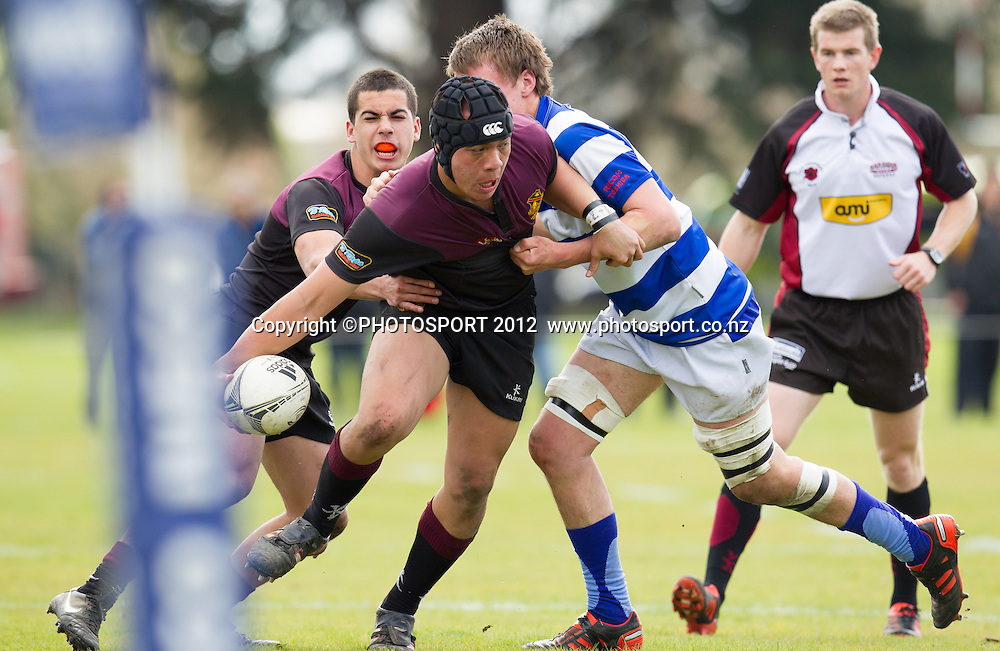 HBHS's Tallis Karaitiana is caught in tackle of St Kentigern's Liam Morris during the College 1st XV Rugby Semi Final - St Kent's v Hamilton BHS won by St Kent's 29-13, at Rotorua Boys High School, Rotorua, New Zealand, Saturday 8 September 2012.  Photo: Stephen Barker/Photosport.co.nz