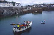 AF4WH6 Fishing boat Porthleven harbour Cornwall England