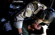 A Pararescueman with the 129th Expeditionary Rescue Squadron, cares for a wounded Afghan National Army Soldier, Hemland Province, Afghanistan. He will provide care to the injured soldier until they can safely deliver him to a hospital.