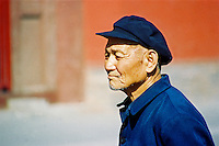 China, Datong, 2008. A senior citizen takes an afternoon stroll near the northern industrial city of Datong in Shanxi Province. The elderly are usually cared for at home in China's family-oriented society.