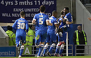 Brighton's Kazenga LuaLua is congratulated for his goal during the Sky Bet Championship match between Brighton and Hove Albion and Derby County at the American Express Community Stadium, Brighton and Hove, England on 3 March 2015. Photo by Phil Duncan.