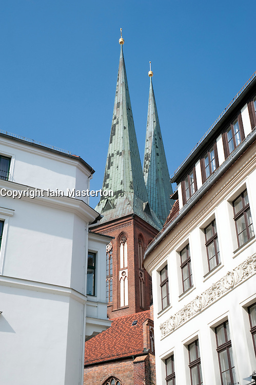old buildings with  Nikolaikirche church appearing in the background in historic Nikolaiviertel district of Berlin 2009