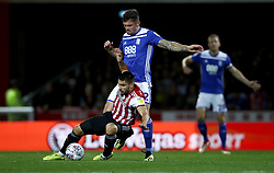 Brentford's Neal Maupay, (left) battles for possession of the ball with Birmingham City's Harlee Dean, (right)