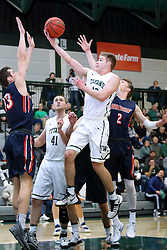 07 January 2017:  Brady Rose lifts a lay up over Kobe Eichelberger during an NCAA men's division 3 CCIW basketball game between the Wheaton Thunder and the Illinois Wesleyan Titans in Shirk Center, Bloomington IL