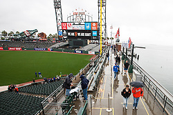 SAN FRANCISCO, CA - APRIL 09:  Fans walk through AT&T Park during a rain shower before the game between the San Francisco Giants and the Los Angeles Dodgers on April 9, 2016 in San Francisco, California.  (Photo by Jason O. Watson/Getty Images) *** Local Caption ***