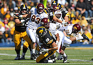September 22 2012: Iowa Hawkeyes tight end C.J. Fiedorowicz (86) is hit by Central Michigan Chippewas linebacker Shamari Benton (26) after a catch during the first half of the NCAA football game between the Central Michigan Chippewas and the Iowa Hawkeyes at Kinnick Stadium in Iowa City, Iowa on Saturday September 22, 2012. Central Michigan defeated Iowa 32-31.