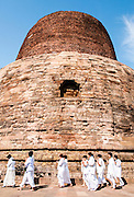Worshipers at the Dhamekh Stupa, Sarnath where Gautama Buddha first taught the Dharma, Near Varanasi India