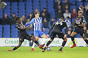 Crystal Palace #23 Pape Souare tackles Brighton and Hove Albion midfielder Solomon (Solly) March (20) during the The FA Cup 3rd round match between Brighton and Hove Albion and Crystal Palace at the American Express Community Stadium, Brighton and Hove, England on 8 January 2018. Photo by Phil Duncan.