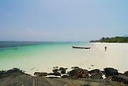 Man walking down the beach in Viveros island. Las Perlas Archipelago, Panama province, Panama, Central America.