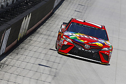 April 13, 2018 - Bristol, Tennessee, United States of America - April 13, 2018 - Bristol, Tennessee, USA: Kyle Busch (18) bring his racecar down the backstretch during opening practice for the Food City 500 at Bristol Motor Speedway in Bristol, Tennessee. (Credit Image: © Chris Owens Asp Inc/ASP via ZUMA Wire)