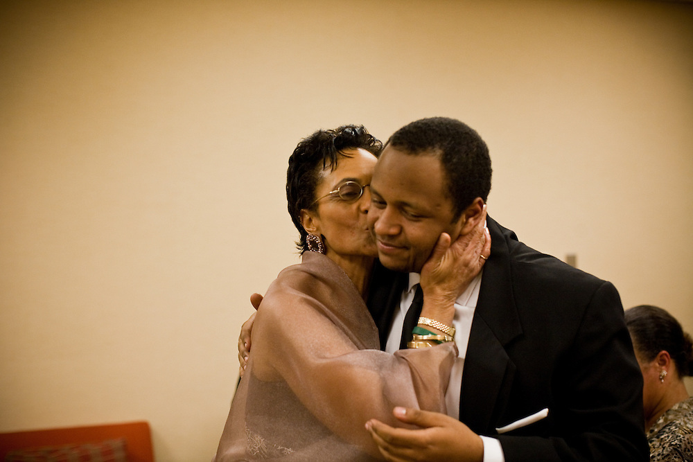 NATIONAL HARBOR, MD - DECEMBER 6: Christa Beverly Baker kisses her son Rushern Baker IV during the inaugural ball celebrating her husband Rushern Baker III's inauguration at Gaylord National Convention on December 6, 2010 in National Harbor, Maryland. (Photo by Michael Starghill, Jr.)