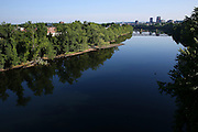 Early morning reflections on the Merrimack River in Manchester, NH Thursday, Aug. 11, 2016.  The river slices through the old mill city. <br /> To help combat Manchester New Hampshire's huge drug problem, anyone can walk into the main fire station seeking help, they'll get connected with a drug counselor and services. Something like 230 people have shown up in the first couple months and it's quickly spawning copy-cat programs.  <br />    (Cheryl Senter for The Wall Street Journal)