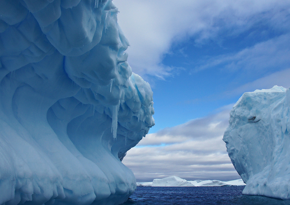 A iceberg in the form of a wave.  The photograph was taken in Antarctica.