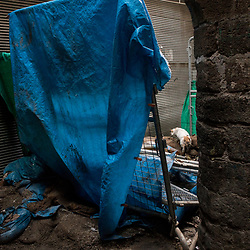 A barrier set by authorities blocks the entrance to destroyed parts of the Savas neighborhood in the Sur district in Diyarbakir, Turkey. Photographed on March 21, 2017.