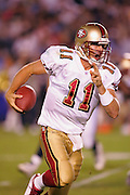 SAN DIEGO - SEPTEMBER 1:  First round draft pick (#1 overall) rookie quarterback Alex Smith #11 of the San Francisco 49ers gets chased out of the pocket against the San Diego Chargers during a preseason game on September 1, 2005 at Qualcomm Stadium in San Diego, California. The Chargers defeated the 49ers 28-24. ©Paul Anthony Spinelli *** Local Caption *** Alex Smith