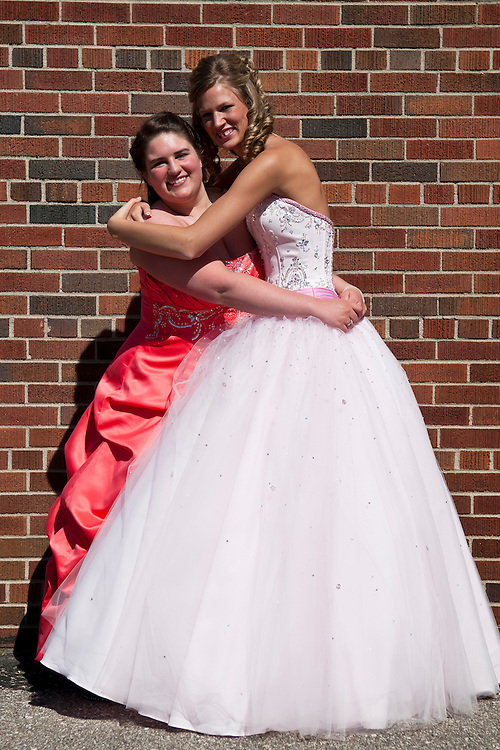 Lathan Goumas | MLive.com..May 11, 2012 - Taylor Nicely and Chelsea Blough before the Genesee High School prom.