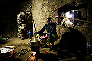 At her home near Arusha, Tanzania Solar Sister entrepreneur Julieth Mollel prepares dinner in her courtyard outside of her kitchen cooking on both her clean wood cookstove and charcoal cookstove she bought from Solar Sister. Cooking at night is easier now with the clean cookstoves that puts out very little smoke and uses only a fraction of the firewood or coal of a traditional three-stone cookstove but also with her Solar Sister solar lantern to light up the area brightly while she works.            Julieth&rsquo;s personal world is brighter because, as a Solar Sister entrepreneur near Arusha, Tanzania, she earns enough money to send her grandchildren to school. Until she started working for Solar Sister in Tanzania life was becoming almost unbearable for Julieth. Cooking over her traditional cook stove made of three stones and an open fire pit put out a lot of smoke that she breathed in when she cooked breakfast, lunch and dinner for her family. <br /> <br /> Julieth has been working for Solar Sister almost since it opened in Tanzania in 2013, almost three years at this time. She heard about the solar lanterns and the opportunity to sell the lanterns and thought she could give it a try. She also learned about the cookstoves and tried the wood cookstove herself first. She soon saw that it used much less fuel than the traditional way of cooking and that she did not have to gather as much firewood. She was also pleased that it put out very little smoke. She decided that she could sell these solar lanterns and cookstoves herself. She has had a lot of success selling the products to her community which consists of small scattered farms. <br /> <br /> Julieth is helping to support her grandchildren to go to school and her granddaughter Ritha just graduated from a private primary school and is taking exams to get into the secondary school. While she still supplements her income by selling crops she is able to have a little savings put aside from her Solar Sister sales. Sh