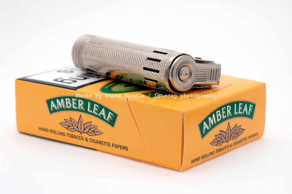 Packet of Amber Leaf Hand Rolling Tobacco and Petrol Lighter