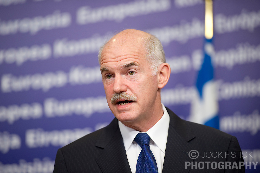"George Papandreou, Greece's prime minister, speaks during a press briefing at the European Commission headquarters in Brussels, Belgium, on Wednesday, March 17, 2010. German Chancellor Angela Merkel said the European Union must avoid any ""overly hasty"" aid pledge to Greece. (Photo © Jock Fistick)"