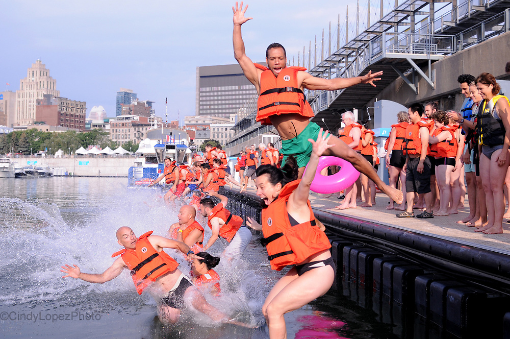 Hundreds of brave swimmers jumped into the St Lawrence River in the Old Port Friday morning as part of Le Grand Splash. Organized by Le Comite Citoyen Montreal Baignade as a promotion of improving the quality of the St Lawrence waterways. August 11 2017. (Cult MTL)