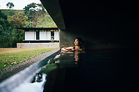 Kandy, Sri Lanka -- February 4, 2018: A young Asian woman in a spa pool at Santani Resort near the Knuckles Mountain Range.
