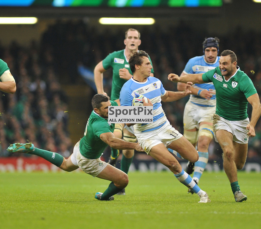 Juan Imhoff of Argentina evades Irish tacklers on his way to score during the IRB RWC 2015 Quarter Final match between Ireland and Argentina at Millenium Stadium on Sunday 18 October 2015, Cardiff, England. (c) Ian Nancollas | SportPix.org.uk