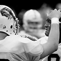 Fargo South's Julius Midell, right, is consoled by teammate Lucas Seltvedt after their loss to Bismarck during the 2008 Dakota Bowl N.D. Football Championships at the Alerus Center in Grand Forks.