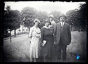 adult group standing in a park tall grass field France circa 1930s