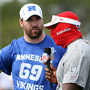 Isaako Sapoaga's San Francisco 49er Defensive Tackle teammate, Justin Smith aka Ninja Assassin, interviews Minnesota Vikings Defensive End,  Jared Allen.  As an AFC player, Justin Smith went undercover in plain sight as he was not supposed to be at an NFC practice.  Photo by Barry Markowitz, 1/26/12