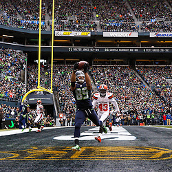 Seattle Seahawks wide receiver Doug Baldwin (89) catches a touchdown against Cleveland Browns cornerback Charles Gaines (43) during the first quarter at CenturyLink Field.