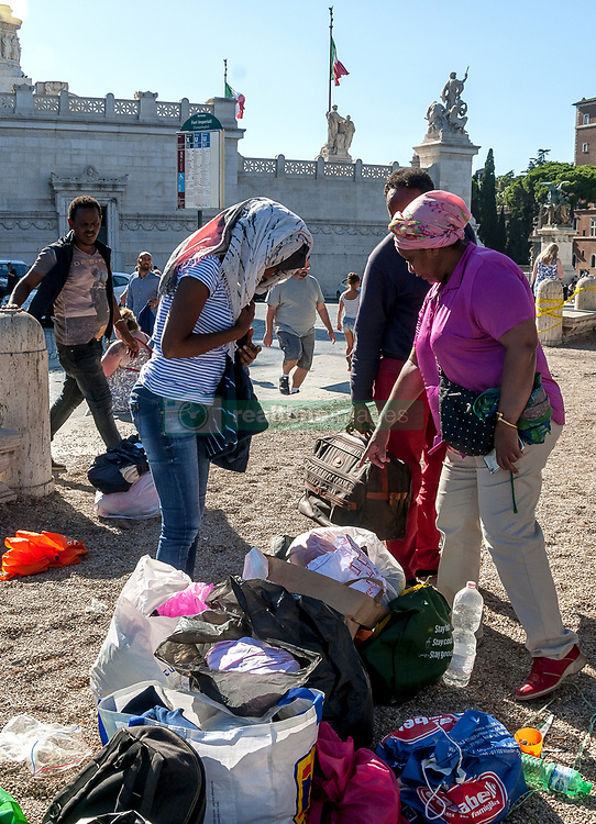 September 5, 2017 - Rome, Italy - Next unloaded - seamlessly - for refugees cleared on August 19 from a busy building four years earlier in Independence Square and still exiled with violence by police with the hydrants on August 24th from the gardens in front of the cleared building where they had slept for 5 nights. From August 26, refugees slept in Venice Square. (Credit Image: © Patrizia Cortellessa/Pacific Press via ZUMA Wire)